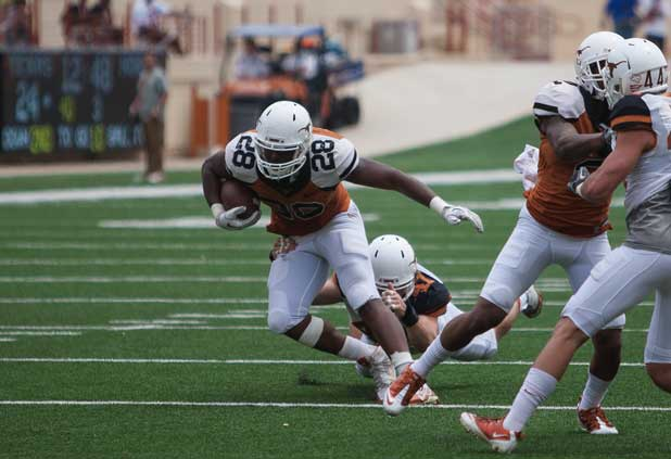 Running back Malcolm Brown finds some space during the Orange-and-White game (Photo: Don Bender).