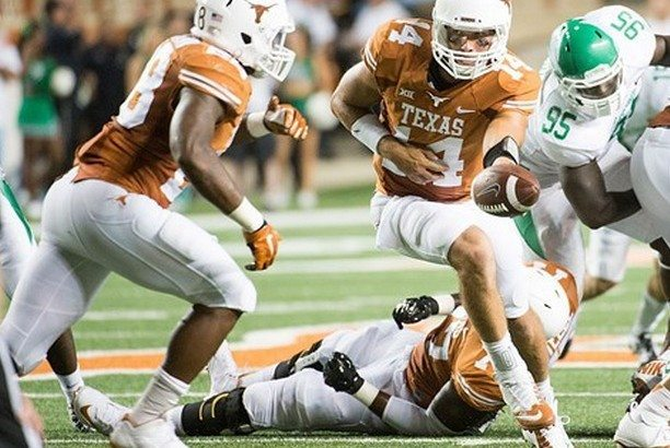 David Ash hands the ball off to Malcolm Brown against North Texas (Photo: courtesy Texassports.com).