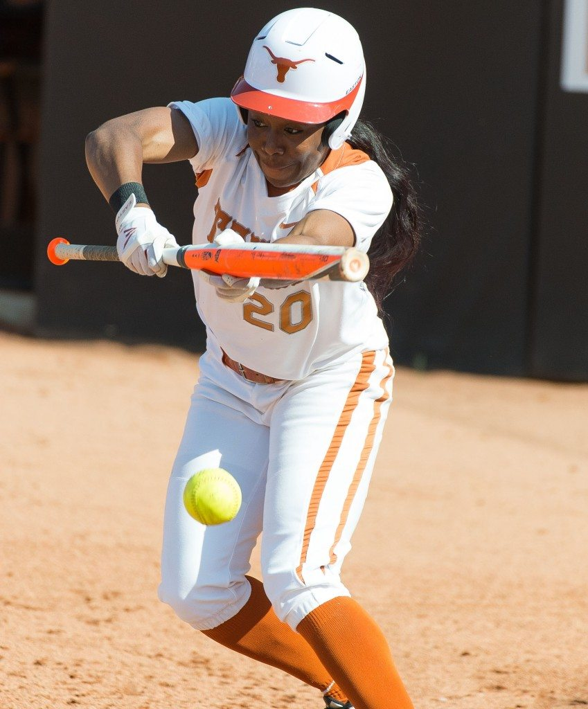 Brejae Washington bunts against Oklahoma State on Fri April 25, 2014. (photo: Jesse Drohen)