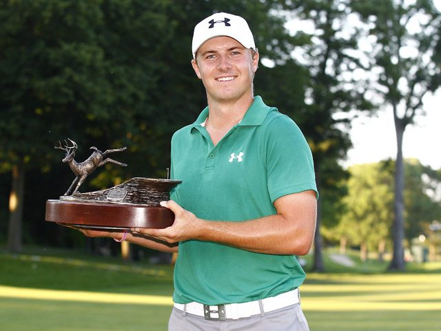 Jordan Spieth holds up the champioship trophy from last year's John Deere Classic. (Photo: courtesy thesportsquotient.com)