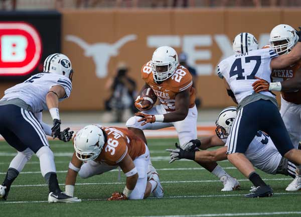 Running back Malcolm Brown runs against BYU on Saturday Sept. 6 2014 (Photo: Don Bender).