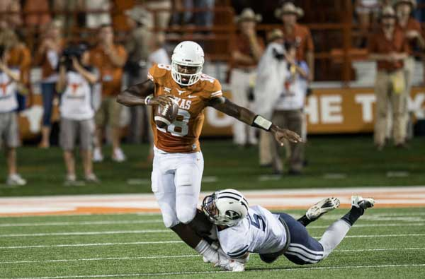 Tyrone Swoopes get tackled by a BYU defender (Photo: Don Bender).