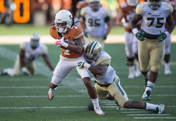 Texas wide receiver Marcus Johnson drags a Baylor wide receiver (Photo: Don Bender).