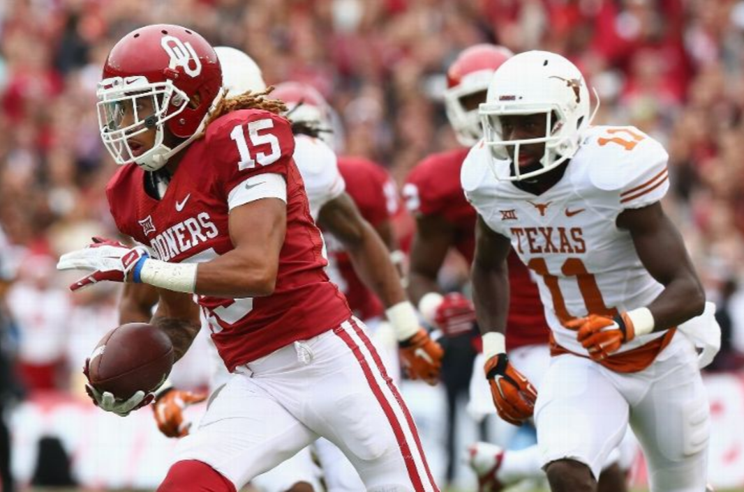 Zack Sanchez returns an interception for touchdown in a 31-26 Oklahoma victory over Texas. ((Photo by Ronald Martinez/Getty Images)