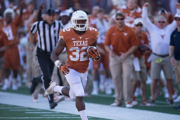 With three touchdown runs and over 100 yards on the ground, Johnathan Gray led the Texas rushing attack against West Virginia (Photo: Don Bender)