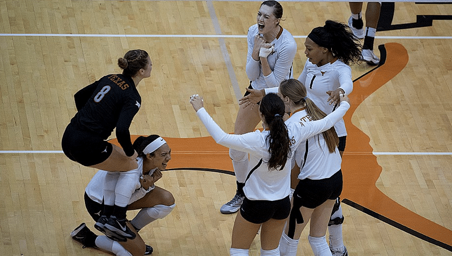 Volleyball celebrates sweeping Arizona State in the NCAA Second Round (Photo: courtesy Texassports.com).