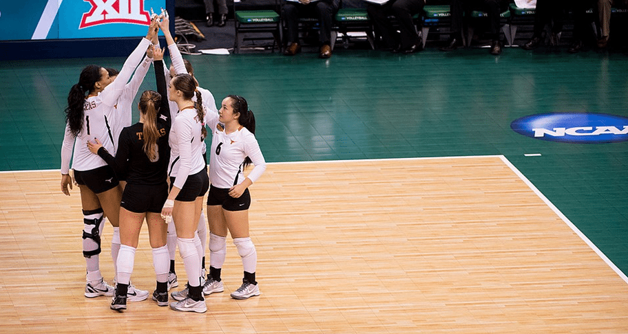 The Texas volleyball team huddles at the NCAA National Championship Semifinal Game (Photo: courtesy Texassports.com).
