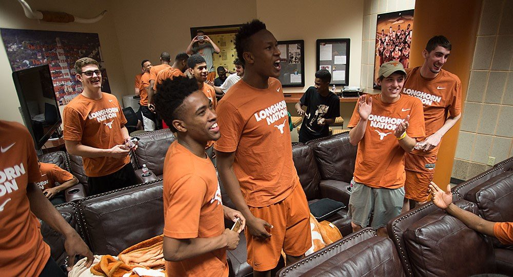 The Texas basketball team celebrates their selection as a 11 seed in the NCAA Tournament (Photo: courtesy UT Athletics Photography).