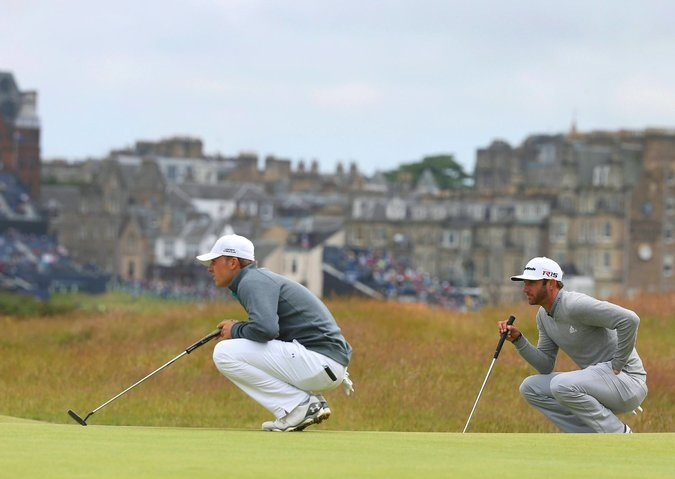 Jordan Spieth, left, and Dustin Johnson on the British Open's 16th green yesterday. Spieth's short game and Johnson's power helped them climb the leaderboard. Credit Eddie Keogh/Reuters