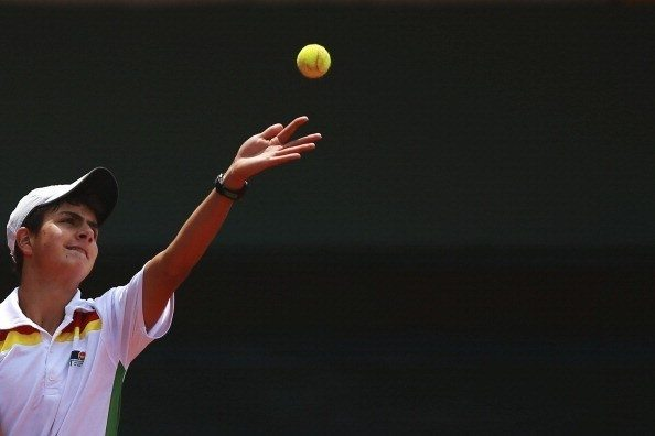 TRUJILLO, PERU - NOVEMBER 17: Rodrigo Banzer from Bolivia serves the ball in Tennis event as part of the XVII Bolivarian Games Trujillo 2013 at Golf and Country Club on November 17, 2013 in Trujillo, Peru. (Photo by Hector Vivas/LatinContent/Getty Images)