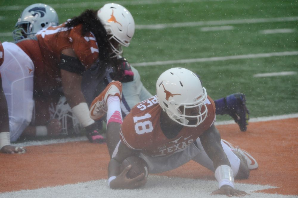 Tyrone Swoopes falling into a wet endzone.