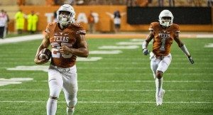Freshman running back Chris Warren led the Texas offense, rushing for 276 yards and four touchdowns in the Longhorns' 48-38 loss to Texas Tech that ended UT's hopes of bowl eligibility (photo courtesy of texassports.com).