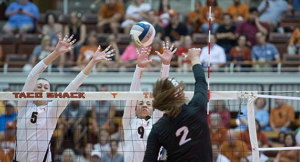 Molly McCage (5) and Amy Neal (9) combined for 26 kills as the University of Texas volleyball team rolled past Purdue, 3-1, to reach the Regional Semifinal (photo courtesy of texassports.com).