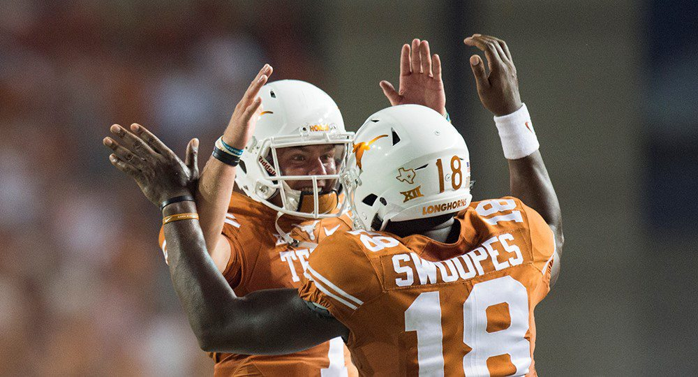Freshman Shane Buechele, left, got the start, but it was Tyrone Swoopes who scored a pair of overtime touchdowns to life the Texas Longhorns to a dramatic 50-47 victory over No. 10 Notre Dame (photo courtesy of texassports.com).