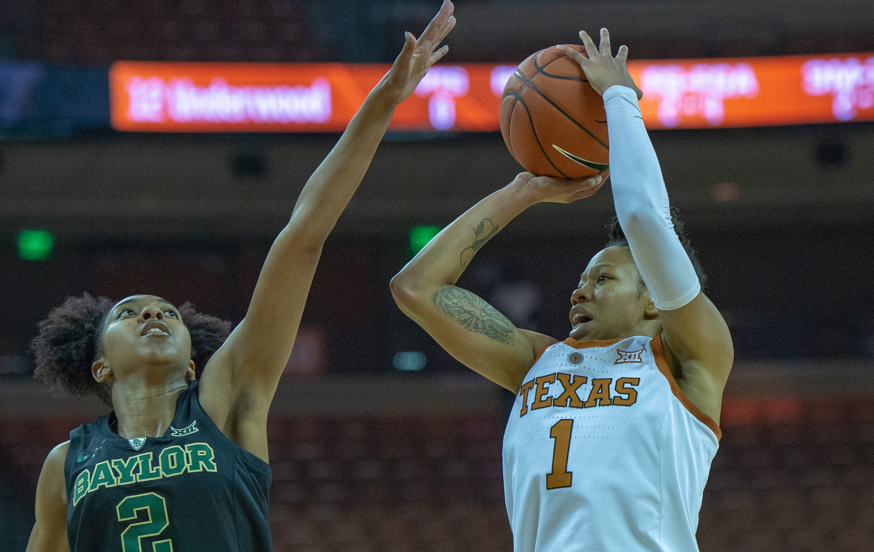 Junior guard Sug Sutton shoots over Baylor guard DiDi Richards