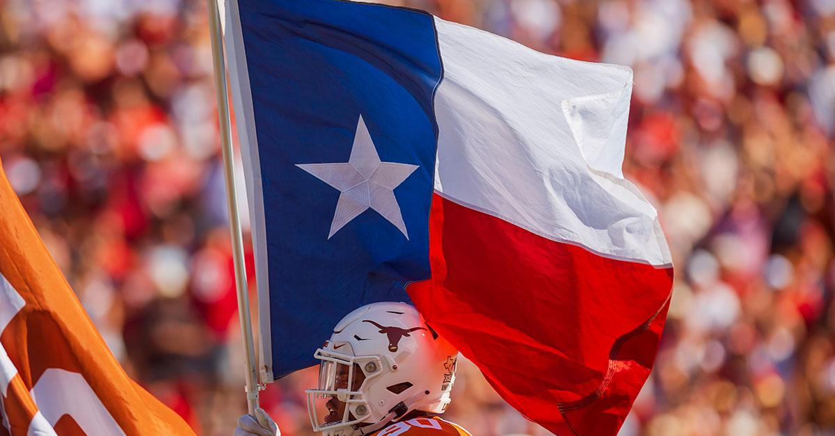 Texas carrying the Texas Flag